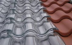 SolTech Energy has developed unique home heating system contained within roofing tiles made out of ordinary transparent glass.