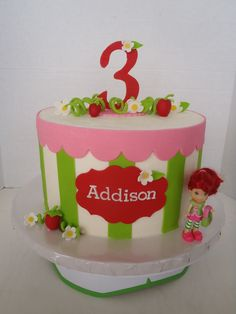 Strawberry Shortcake!  Buttercream iced cake with fondant details and toy figure.