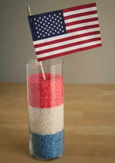 Red, White, and Blue Rice Centerpiece - White uncooked rice, rubbing alcohol, food coloring (red and blue), a clear vase.  Divide your rice into 3 equal parts. Place 2 of the parts into 2 baggies, one for red and one for blue. The third part you'll leave plain white. Add food coloring to each bag (8-10 drops for each color). Add 1 tsp of rubbing alcohol to each bag. This helps with the drying of the rice.