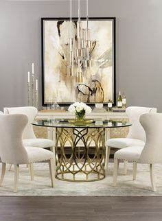 Modern Glamour: Soft, timeless colors get a contemporary spin in this radiant dining room. The buffet's shimmery shell inlay catches the light from the modern glass pendants. #luxuryinterior #luxurydesign #topinteriors