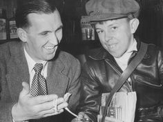 1953: Dan Curtain, licensee of the Turf Club Hotel in North Melbourne, presents local paperboy Peter Hargraves with a watch for his 15th birthday. A collection was taken up for him by his grateful customers. Picture: Herald Sun Image Library/ ARGUS