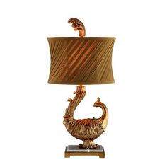 This beautiful peacock lamp is finished in elegant gold. This lamp requires one 100-watt light bulb which is not included.