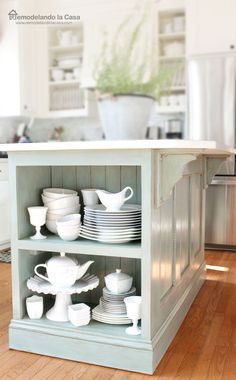 Add a bookshelf to the end of an island - Kitchen Island Makeover - A builder's grade kitchen island transformation