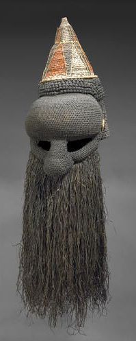 Africa | A Akish, for the Indagani Society ~ Salampasu people, DR Congo ~ mask | Cloth, wicker and fiber with a conical hat above an exaggerated forehead above large, sunken eyes and bulbous nose, with long fiber hanging down form the base; highlighted with dark orange, white and black pigments