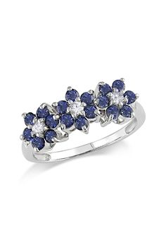 10K White Gold Sapphire & Diamond Flower Ring. I'm not a jewelry person, but this would be a lovely gift to pass down to my grand daughter