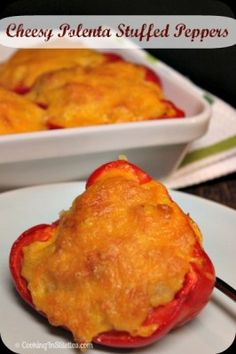 Cheesy Polenta Stuffed Peppers are perfect for a #PepperParty.  Red Bell Peppers stuffed with a cheesy corn polenta.    http://cookinginstilettos.com/cheesy-polenta-stuffed-peppers/    #Meatless   #Cheese
