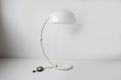 FLOOR LAMP BY ELIO MARTINELLI https://www.galerie44.com/collection/luminaires/lampadaire-elio-martinelli-modele-serpente-edition-martinelli-luce-1970-details