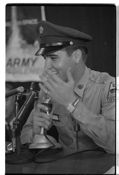 Private Elvis Presley photographed at his press conference at Brooklyn Army Terminal in New York City on Monday, 22 September 1958 shortly before his departure for Germany aboard the troop transport USS General George M. Randall. Listen to the press conference: https://www.youtube.com/watch?v=VhwpCbp5PbQ Also watch: https://www.youtube.com/watch?v=tX6SjU1-7WA