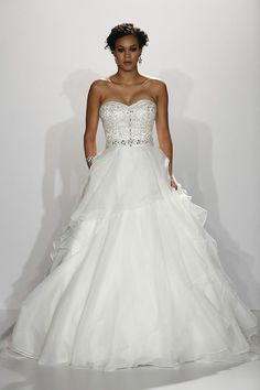Ball gown wedding dress with beaded corset top by Maggie Sottero