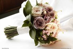 Vintage hand-tie bouquet with pale pink Sweet Avalanche roses, pink astilbe, Amnesia roses and pink bouvardia, Exclusively Weddings. Photo by Richard Lines