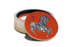 Waylande Gregory Studios at BECKER MINTY - a stacked caddy of orange reverse painted coasters in a playful prancing zebra design. #waylandegregory #waylandegregorystudio