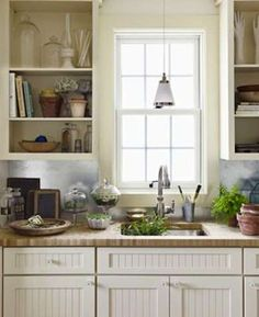 Galvanized Metal Metal backsplashes are typically of the stamped variety, but a flat sheet of galvanized metal makes a clean and modern statement in a country kitchen or mudroom potting area.