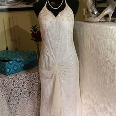 Ivory beaded wedding/formal Beautifully beaded halter gown. Not to heavy to be worn comfortably. Rushing in just the right figure flattering places. I wear a 6-8 and this fits perfectly. Only worn once I will ship this with a clear plastic garment bag and ships in brand new storage box shown in last photo! Sean Collection Dresses Wedding