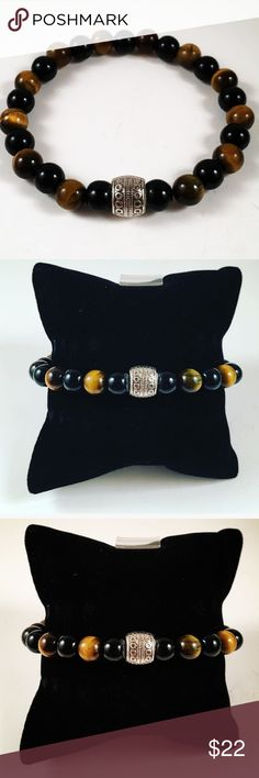 Men Tiger eye and onyx beaded bracelet Men beaded bracelet. Fits most , 7.5 to 8.5 inch wrist. Made out of Onyx and golden eye Tiger eye gemstones. Tibetan silver accent deco charm. Handmade by me . Never worn by anyone. I ship fast!!✈️ Free gift with every purchase!! Accessories Jewelry