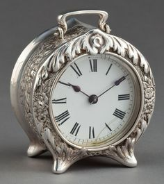 Vintage sterling silver carriage clock on four feet with repoussé decorations by Tiffany & Co. NewYork, c. 1887