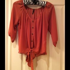 Sheer blouse Sheer summer top in tangerine. Looks great with ant color tank underneath and a statement necklace. Can dress up or down with jeans, dress pants or skirt. Tops Blouses