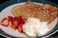 low carb cream cheese pancakes with strawberries and cream - suitable for keto, paleo, atkins diet