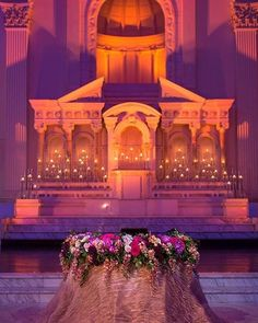 A dramatic glow of amber and fuschia lighting created the perfect backdrop for this sweetheart table at @vibianaevents. (Venue: @vibianaevents / Food  Beverage: @nealfraser @tobinshea / Event Planner: @socaleventplanners / Florals & Decor: @bloomboxdesigns / Dance Floor: @hcd_portable_dancefloors / Entertainment: Salar Nader / Videography: A&A Video / Photography: @embracelifeadam / Photo Booth: @thebosco / Cake: Cakes by Mahnaz)