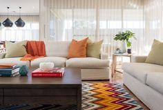 Modern Living Room with Hardwood floors, Fatboy Cuscino Stonewashed Floor Pillow, Sam Moore Carson Sofa - Linen