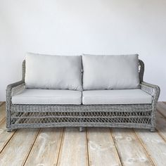 Woven from lightweight, 100%-recyclable synthetic fibers over a fully-welded aluminum frame, this open weave sofa with all-weather cushions was design