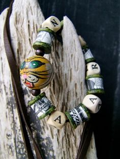Boy's bracelet - camo /comic themed bead bracelet. Nice painting technique on these.
