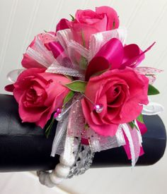 Hot pink and white wrist corsage by Ballard Blossom. Prom flowers, Seattle