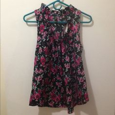 Ruffled collared satin tank Black satin razor back tank top with pink flowery design. Ruffled collar. Great condition. Tops Blouses