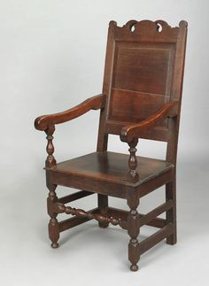 Realized Price: $42120   Southeastern Pennsylvania William & Mary walnut wainscot armchair, ca. 1720, with a pierced and scalloped crest, raised panel back flanked by downward sloping arms and turned blocked legs joined by baluster and ring turned medial stretcher and double side stretchers. For a similar example. see Kindig, The Philadelphia Chair, fig. 4; and Schiffer, Furniture and It's Makers of Chester County, Pennsylvania, fig. 162. A nearly identical chair, most likely from the same…