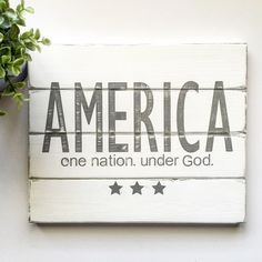 AMERICA one nation. under God. Shiplap inspired sign is now available in my shop. Just in time to decorate for the 4th of July holiday. This sign is perfect for your neutral farmhouse decor. Visit my shop today for more decor inspiration.