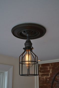 I love this Etsy Shop- Ceiling Mounted Industrial Short Steel Pipe by WestNinthVintage, $57.00