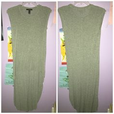 High-low tank top Worn once. Perfect condition. Looks great paired with a jean jacket, leggings and boots! Forever 21 Tops