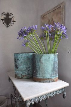 Pretty summer home decor idea for decorating with flowers in vintage metal bins. French Country Living Antiques -