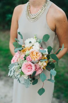 Chic + colorful bridesmaid bouquet: Photography : Caroline Ro - http://carolinero.com/ http://www.stylemepretty.com/south-carolina-weddings/edisto/2016/01/11/elegant-timeless-waterside-southern-wedding/