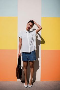 painted walls. White blouse+denim skirt+whit pumps+brown shoulder bag. Summer Casual Outfit 2017