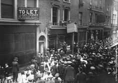 London crowds attack a German business premises in Poplar High Street in the East End of London, 1915