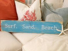 "Wooden Hand-painted Sign ""Surf. Sand. Beach."". $30.00, via Etsy."