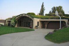 Modern earth sheltered home.  I like the rock work.