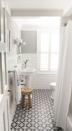 White walls above a patterned tiled floor is one bathroom look that works beautifully.