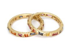 """HARLEQUIN RAPUNZEL RING £1770 The classic Rapunzel band, here with hand-selected mixed-cut sapphires in our extra vibrant """"Harlequin"""" colours. Pictured in 18ct Yellow Gold1.6 SapphiresDimensions: 3mm band"""