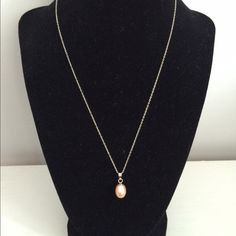 """Pink pearl drop necklace Elegant shimmery pink pearl necklace. Chain is silver and 18"""". Worn once. Jewelry Necklaces"""