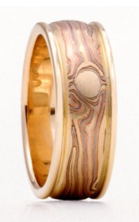 George Sawyer's Mokume Wedding Rings.    Ours wedding rings are similar to this, but white gold where this is yellow gold.  And they are mirror images--so they literally are a matched set.