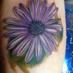 purple daisy tattoo. This would be a good idea but yellow (yellow for Jett the daisy flower for daisy)
