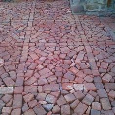 paving with broken and half bricks, concrete masonry, Fill in gaps between circles with smaller broken brick to get this effect