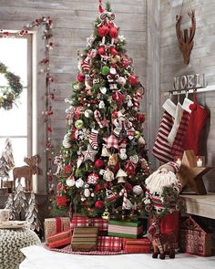 Can you say rustic glam? This Christmas decor is the definition of merry & bright! Love the use of decorative items around the tree--mini trees, the countdown, & Santa!