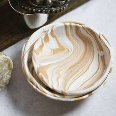 An easy DIY clay bowl. The perfect catch-all for your bookcase or nightstand.