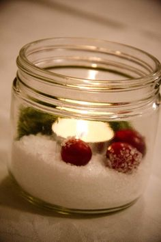 Christmas centrepiece made from a mason jar, epson salts, pine sprig and cranberries
