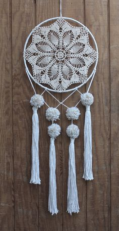 12 neutral tone, crocheted, lace dreamcatcher made with unbleached, hand-knotted cotton, salvaged materials and decorated with pom poms & tassels.