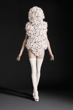 I'm in love with this garment! It is so elegantly made and striking to the eye. I love how the statement piece is really unusual and has evident texture and volume through geometric form. I dislike the face piece as it isn't very functional or practical.