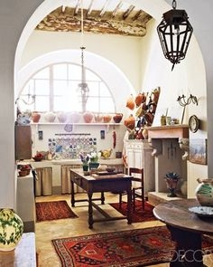 A little cluttered for my taste, but love the light, textures, and shapes of this room.