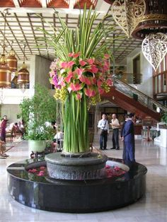 Oversized grand entrance floral arrangement of hala leaves, anthurium and assorted flowers Hotel Flowers, Tall Flowers, Church Flowers, Large Flowers, Tropical Flowers, Hotel Flower Arrangements, Beautiful Flower Arrangements, Flower Centerpieces, Flower Decorations